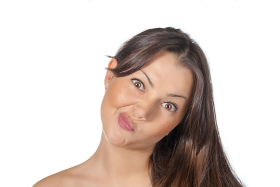 brunette girl making funny face
