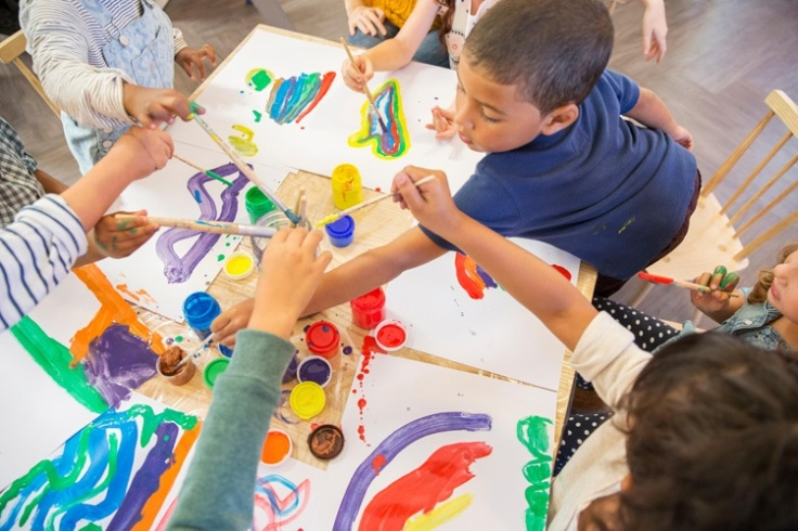 Children painting in class