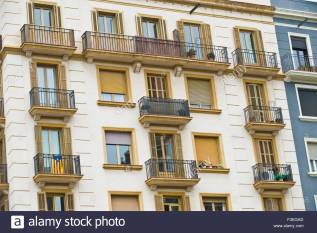 apartments-with-wrought-iron-balconies-and-exterior-wooden-shutters-f3egad