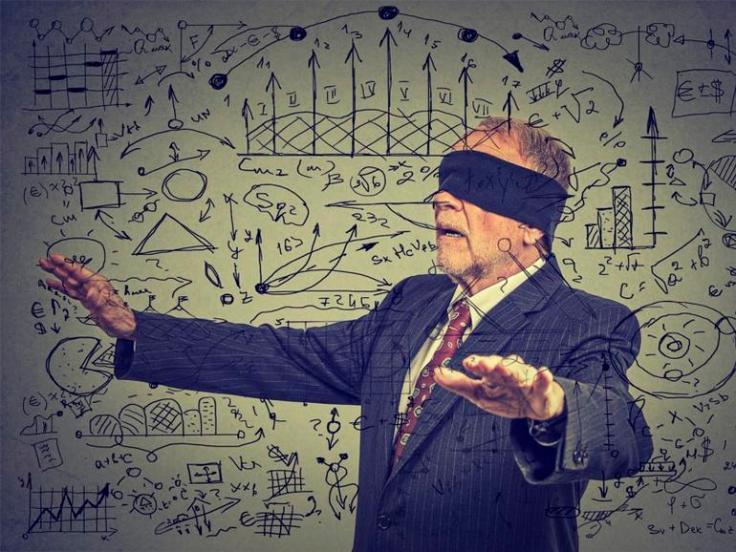 blindfolded senior business man walking through social media data